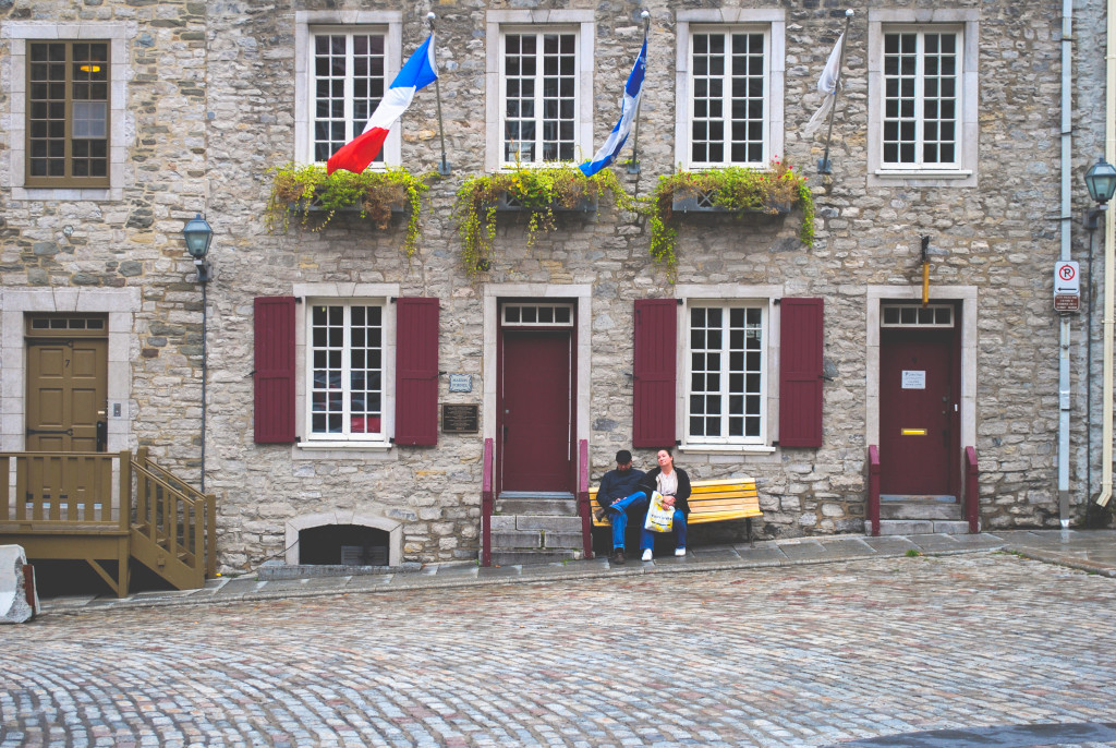 I took this photo in my early photography days when I was using a point-and-shoot camera to learn framing and composition. My photography teacher told me that learning how to work with composition and lighting are the most important part of photography. Also, I just really liked how these folks were sitting on the bench enjoying the weather! Old Quebec City, 2010